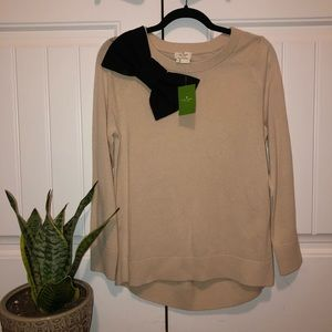Cream colored Kate Spade sweater with bow